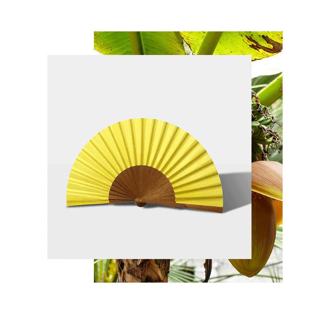 Pleat Brand hand fan in yellow