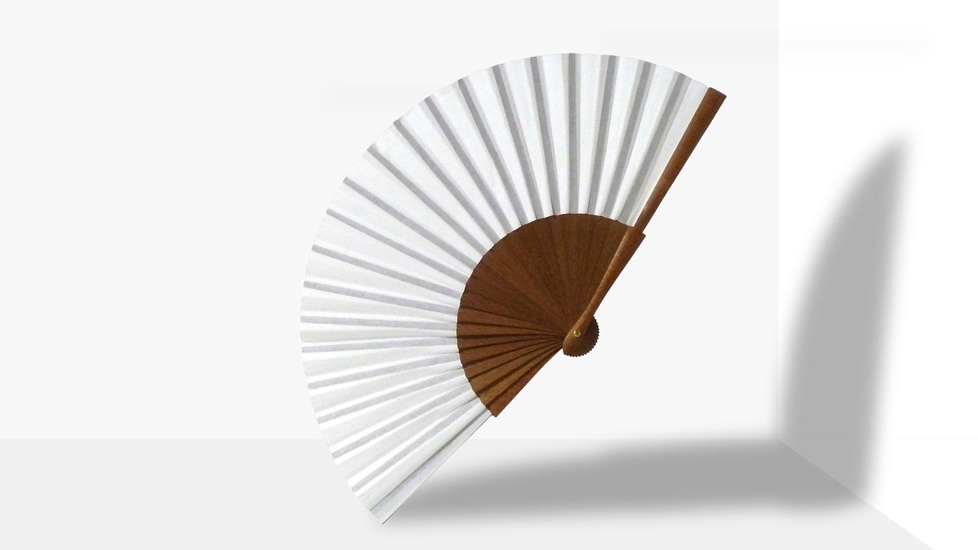 Pleat Brand hand fan in white.