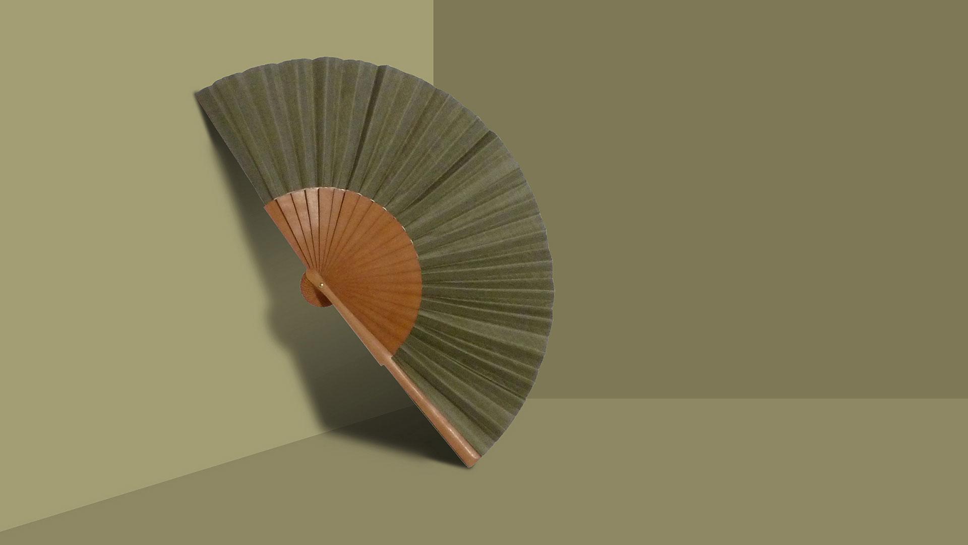 Pleat Brand hand fan in olive.